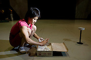 Cao Xiaoli, a professional acrobat, prepares to practice balancing on one hand at Shanghai Circus World in Shanghai, China.  (Cao Xiaoli is featured in the book What I Eat: Around the World in 80 Diets.)  The caloric value of her day's worth of food on a typical day in June was 1700 kcals.  She is 16 years of age; 5 feet, 2 inches tall; and 99 pounds.  Cao Xiaoli lives in  a room with nine other girls. She started her career as a child, performing with a regional troupe in her home province of Anhui. Now she practices five hours a day, attends school with the other members of her troupe, and performs seven days a week. She says what she likes best about being an acrobat is the crowd's reaction when she does something seemingly dangerous. MODEL RELEASED.