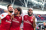 Arsenal forward Olivier Giroud (12), Arsenal forward Lacazette (9), Arsenal midfielder Mohamed Elneny (35) celebrate win  the FA Community Shield match between Arsenal and Chelsea at Wembley Stadium, London, England on 6 August 2017. Photo by Sebastian Frej.