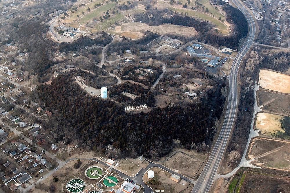 """Bluemont Hill from above shows the familiar """"MANHATTAN"""" cement letters as well as Manhattan Country Club."""