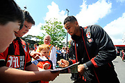 AFC Bournemouth forward Joshua King signing autographs as he arrives for the Premier League match between Bournemouth and Burnley at the Vitality Stadium, Bournemouth, England on 13 May 2017. Photo by Graham Hunt.