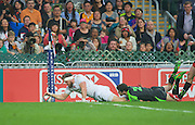 Phil Burgess  scores during the Hong Kong Sevens 2015 match between England and Wales at Hong Kong Stadium, Hong Kong on 27 March 2015. Photo by Ian Muir....during the Hong Kong Sevens 2015 match between ........... at Hong Kong Stadium, Hong Kong on 27 March 2015. Photo by Ian Muir.