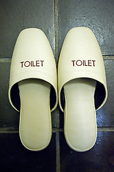 Detail of special slippers to wear in toilet area in traditional Japanese hotel