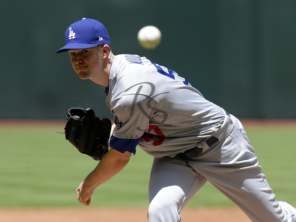 Los Angeles Dodgers starting pitcher Alex Wood (57) in the first inning during a baseball game against the Arizona Diamondbacks, Thursday, May 3, 2018, in Phoenix. (AP Photo/Rick Scuteri)