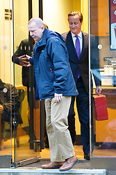 © Licensed to London News Pictures. 04/01/2015. LONDON, UK. Prime Minister David Cameron leaving a Starbucks before taking part on the The Andrew Marr show on BBC One at BBC Broadcasting House in London on Sunday, 4 January 2014. Photo credit : Tolga Akmen/LNP