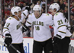 Oct 8; Newark, NJ, USA; Dallas Stars left wing Loui Eriksson (21) and Dallas Stars left wing James Neal (18) celebrate Eriksson's goal during the second period of their game against the New Jersey Devils at the Prudential Center.