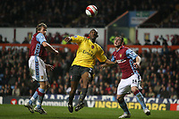 Photo: Rich Eaton.<br /> <br /> Aston Villa v Arsenal. The Barclays Premiership. 14/03/2007. Arsenals Abou Diaby  centre goes for the ball ahead of Olof Mellberg left and Phil Bardsley right