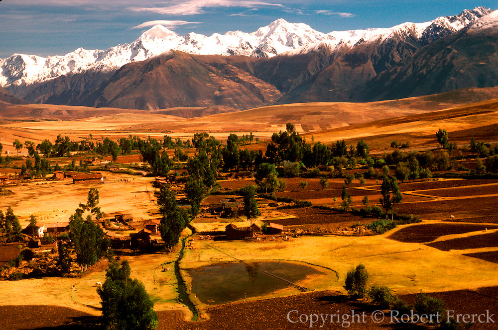 PERU, HIGHLAND, ANDES MOUNTAINS the Cordillera de Urubamba Mountains above fields at Maras near Cuzco
