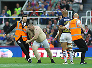 A streaker enter the field and is tackled to the ground by a stadium steward during  Castleford Tigers vs Leeds Rhinos during the Betfred Super League match at the Dacia Magic Weekend, St. James's Park, Newcastle<br /> Picture by Stephen Gaunt/Focus Images Ltd +447904 833202<br /> 19/05/2018