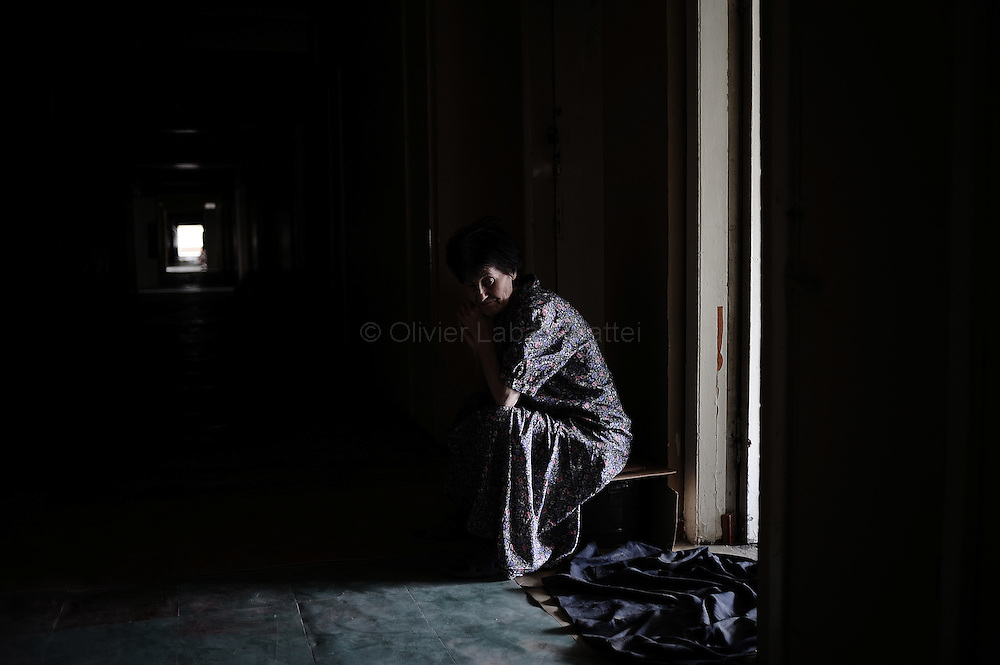 A Georgian woman who fled her village after a Russian attack is pictured in a hall in the former Russian Ministry of Justice on August 29, 2008 in Tbilisi. Russia is facing an avalanche of criticism from the West over its decision to recognise the independence of two Georgian secessionist regions at the heart of the conflict: South Ossetia and Abkhazia.