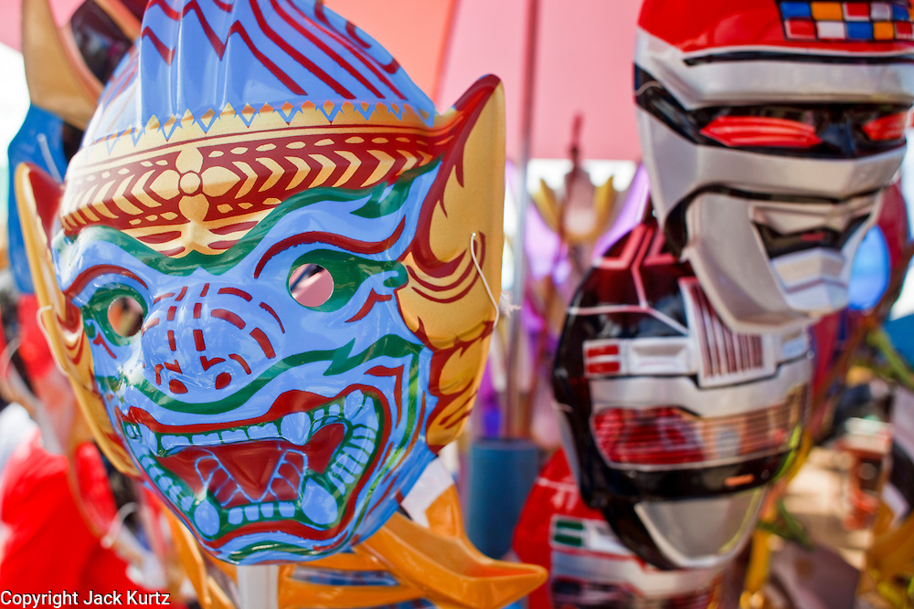 Oct. 3, 2009 - CHONBURI, THAILAND: A traditional Thai mask from the Ramayana on sale with super hero masks in the midway during the first day of races at the Chonburi Buffalo Races Festival, Saturday, Oct. 3. Contestants race water buffalo about 200 meters down a muddy straight away. The buffalo races in Chonburi first took place in 1912 for Thai King Rama VI. Now the races have evolved into a festival that marks the end of Buddhist Lent and is held on the first full moon of the 11th lunar month (either October or November). Thousands of people come to Chonburi, about 90 minutes from Bangkok, for the races and carnival midway. Photo by Jack Kurtz / ZUMA Press
