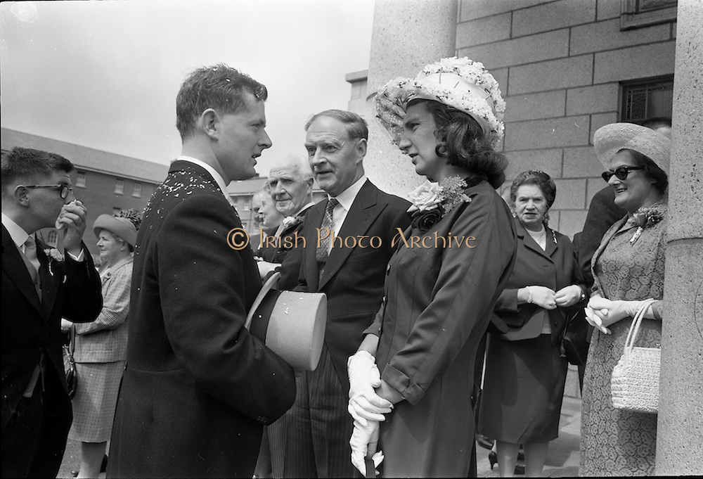 05/07/1967<br /> 07/05/1967<br /> 05 July 1967<br /> Wedding of George Walsh, eldest son of Mr and Ms Kevin G. Walsh, St. Rita's, Firhouse Road, Templeogue, Co. Dublin and Miss Arlene McMahon, elder daughter of Det. Chief Supt. Philip McMahon, Head of Special Branch, Dublin Castle and Mrs McMahon of Lisieux, Templeville Park, Templeogue, Co. Dublin who were married at the Carmelite Church, Terenure College, Dublin. An Taoiseach Mr Jack Lynch and Mrs Lynch; Mr Liam Cosgrave, leader Fine Gael and Mrs Cosgrave were among the 120 guests. Rev Fr H.E. Wright, O. Carm., Moate, officiated at the ceremony. The reception was held at Downshire Hotel, Blessington, Co. Wicklow. groom speaking with Mr and Mrs Cosgrave after the ceremony.