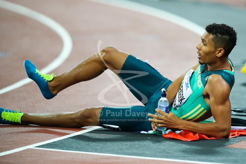 London, August 08 2017 . Wayde van Niekerk, South Africa, rests after becoming world champion in the men's 400m final on day five of the IAAF London 2017 world Championships at the London Stadium. © Paul Davey.