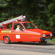 MR JOHN WARD AND HIS HOME MADE WORKING FIRE ENGINE FROM AN OLD RELIANT ROBIN NEAR HIS HOME NEAR SPLADING,LINCS,ON JULY 5TH 2013.