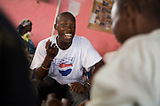 Member of the band King's Jubilee, Zaroe Amilcar, sings during a jamming session with Canadian artist Dave Bidini (unseen)  at the  Buduburam refugee settlement, roughly 20 km west of Ghana's capital Accra on Friday April 13, 2007. The group, which is composed of five Liberian men living at Buduburam, is currently recording their second album, and already has a growing number of fans back in Liberia. The Buduburam refugee settlement is still home over 30,000 Liberians, most of which have mixed feelings about returning to Liberia..