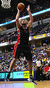 April 09, 2012; Indianapolis, IN, USA;Toronto Raptors center Aaron Gray (34) shoots the ball against the Indiana Pacers at Bankers Life Fieldhouse. Mandatory credit: Michael Hickey-US PRESSWIRE