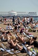 licensed to London News Pictures. LONDON UK. 21/04/11.People flock to Brighton Beach today to catch the sunshine before the start of the Easter Bank Holiday in Britain. Temperatures are set to continue to rise over the weekend. Photo credit should read Stephen Simpson/LNP
