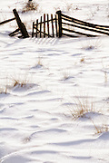 snow scene with wooden fence