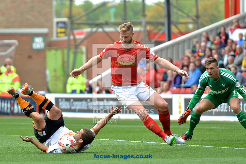 Shaun Maloney of Hull City (left) is fouled by Matthew Mills of Nottingham Forest to win a penalty during the Sky Bet Championship match at the City Ground, Nottingham<br /> Picture by Ian Wadkins/Focus Images Ltd +44 7877 568959<br /> 03/10/2015