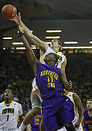December 07 2010: Iowa Hawkeyes guard Eric May (25) blocks a shot by Northern Iowa Panthers guard Kwadzo Ahelegbe (11) during the first half of their NCAA basketball game at Carver-Hawkeye Arena in Iowa City, Iowa on December 7, 2010. Iowa defeated Northern Iowa 51-39.