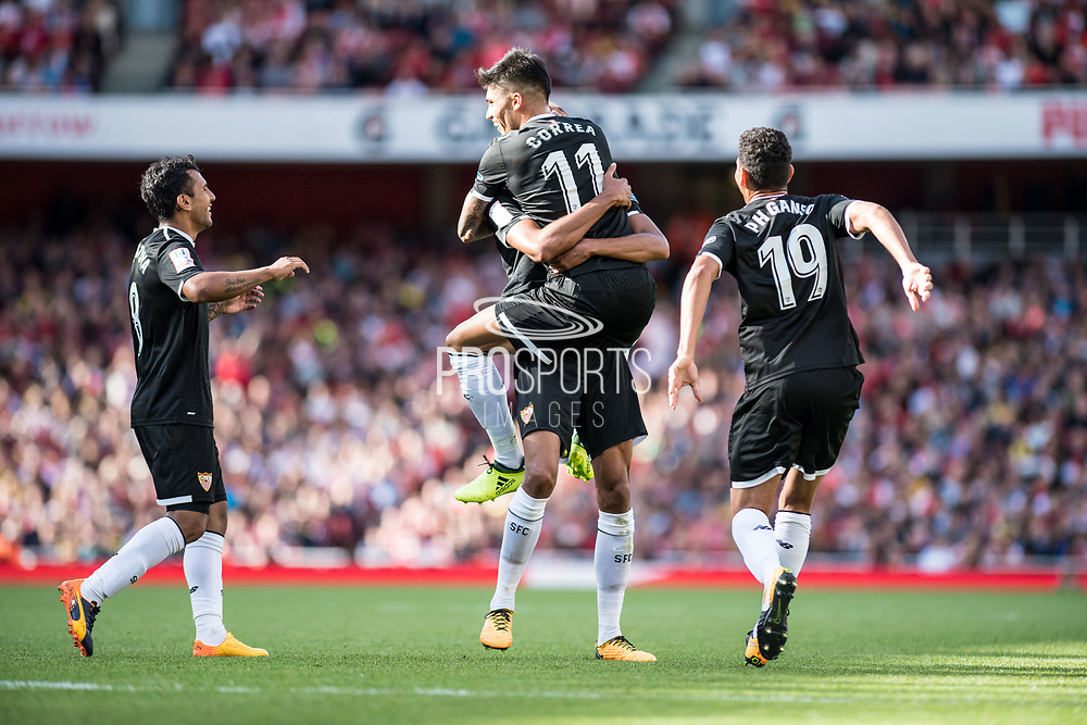 Sevilla midfielder Steven N'Zonzi (15)celebrate scoring goal with team mates ,Sevilla forward Joaquin Correa (11) Paulo Henrique Ganso (19)during the Emirates Cup 2017 match between Arsenal and Sevilla at the Emirates Stadium, London, England on 30 July 2017. Photo by Sebastian Frej.