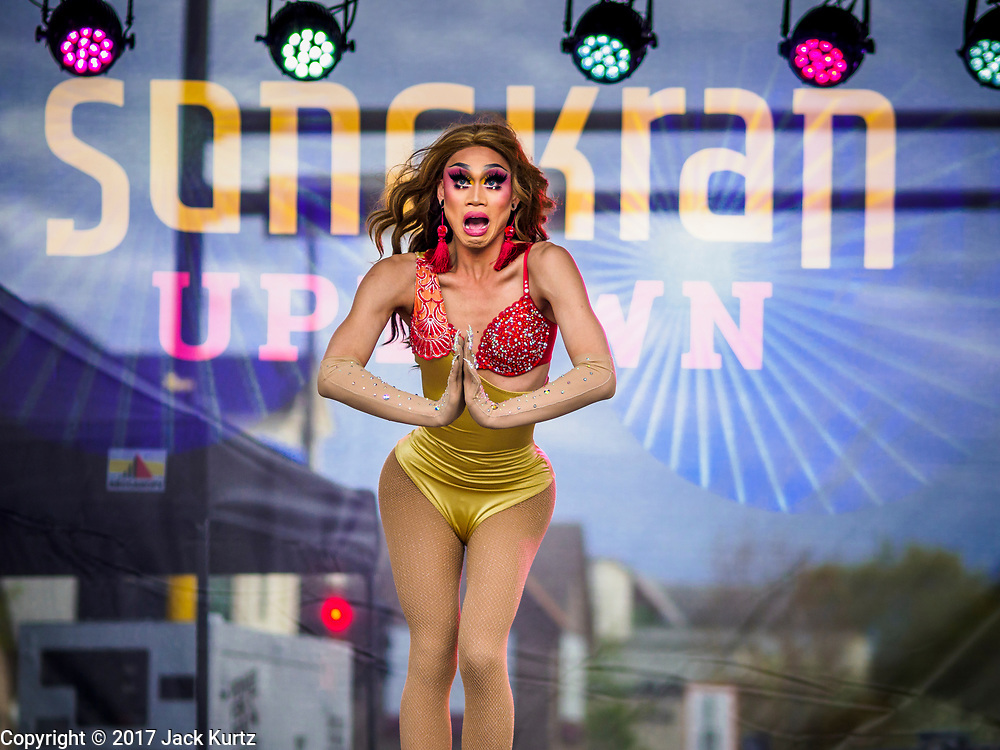 """29 APRIL 2017 - MINNEAPOLIS, MINNESOTA: A """"ladyboy"""" (drag queen) performance at the Songkran Uptown festival. Several thousand people attended Songkran Uptown on Hennepin Ave in Minneapolis for the city's first celebration of Songkran, the traditional Thai New Year. Events included a Thai parade, a performance of the Ramakien (the Thai version of the Indian Ramayana), a """"Ladyboy"""" (drag queen) show, and Thai street food.     PHOTO BY JACK KURTZ"""