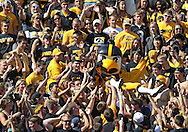 September 29 2012: Iowa Hawkeyes mascot Herky crowd surfs in the student section during the second quarter of the NCAA football game between the Minnesota Golden Gophers and the Iowa Hawkeyes at Kinnick Stadium in Iowa City, Iowa on Saturday September 29, 2012. Iowa defeated Minnesota 31-13 to claim the Floyd of Rosedale Trophy.