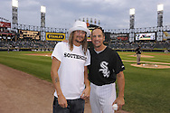 "CHICAGO - JULY 30:  Recording artist Kid Rock (L) poses for a photo with Omar Vizquel #11 of the Chicago White Sox before throwing out a ceremonial first pitch on ""Mullet Night"" prior to the game between the Chicago White Sox and Oakland Athletics on July 30, 2010 at U.S. Cellular Field in Chicago, Illinois.  The White Sox defeated the Athletics 6-1.  (Photo by Ron Vesely)"