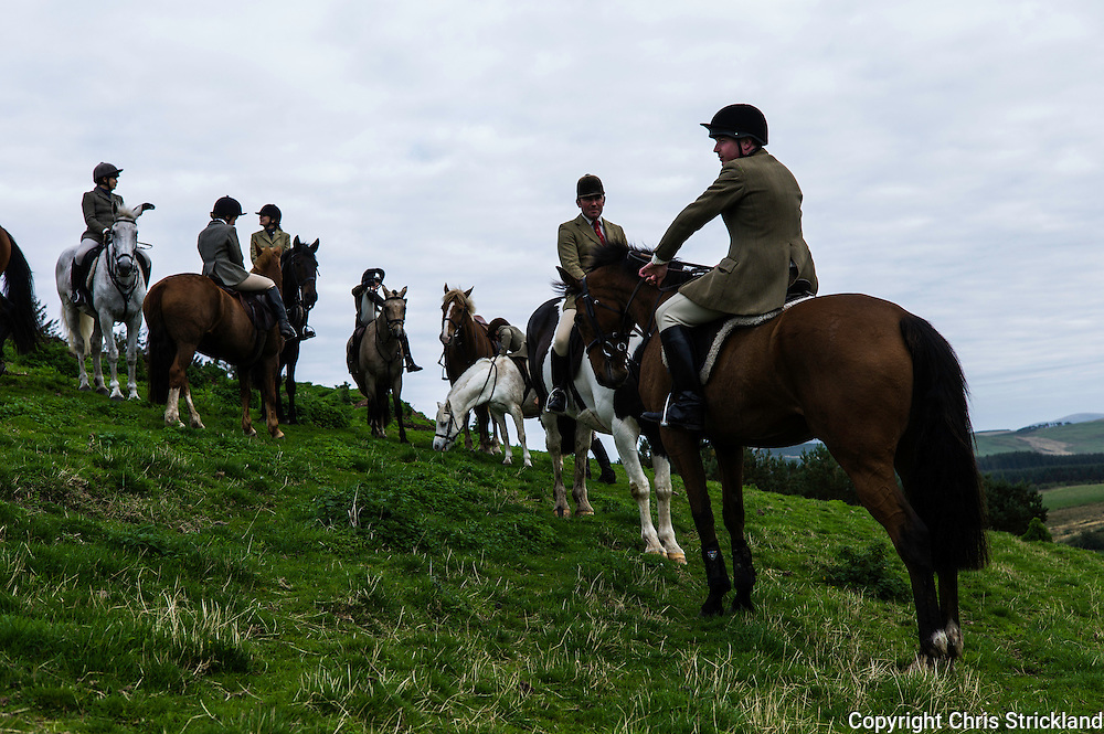 Mounted followers of the Jedforest Hunt in hill country in the Scottish Borders during Autumn Hunting.