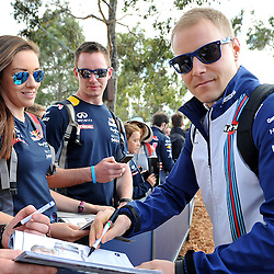 Valtteri Bottas of Williams Martini F1 Team signing autographs.<br /> Round 1 - Second day of the 2015 Formula 1 Rolex Australian Grand Prix at The circuit of Albert Park, Melbourne, Victoria on the 13th March 2015.<br /> Wayne Neal | SportPix.org.uk