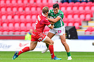Marco Zanon of Benetton Treviso is tackled by Hadleigh Parkes of Scarlets<br /> <br /> Photographer Craig Thomas/Replay Images<br /> <br /> Guinness PRO14 Round 3 - Scarlets v Benetton Treviso - Saturday 15th September 2018 - Parc Y Scarlets - Llanelli<br /> <br /> World Copyright &copy; Replay Images . All rights reserved. info@replayimages.co.uk - http://replayimages.co.uk
