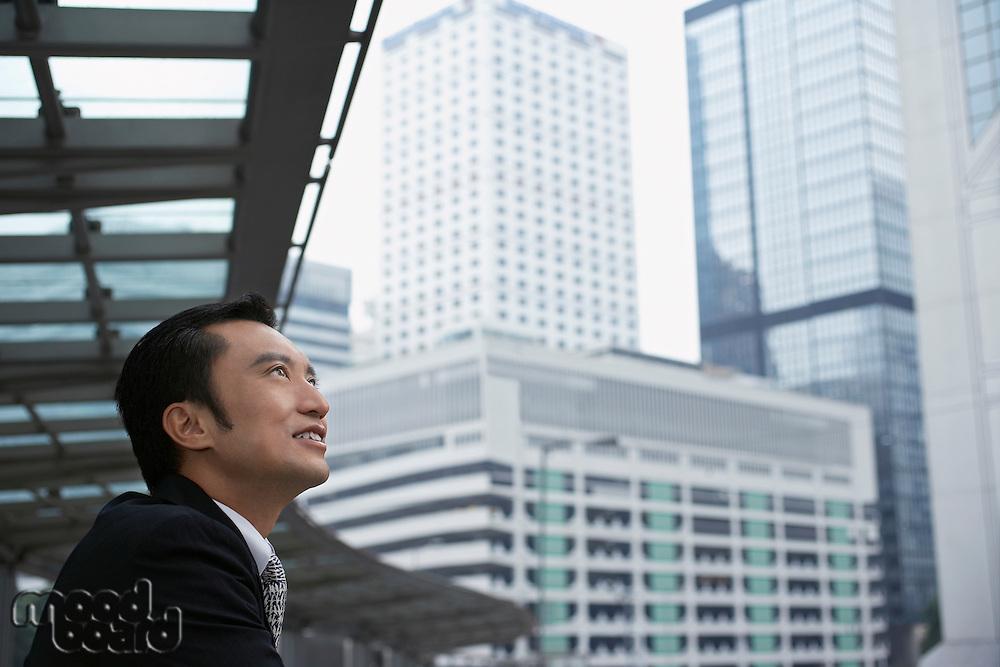 China Hong Kong business man looking at cityscape side view