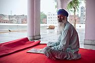 Sikh elderly man at Santokhsar, one of five sarovars (sacred pools) of Amritsar.