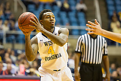Dec 5, 2015; Morgantown, WV, USA; West Virginia Mountaineers guard Daxter Miles Jr. (4) passes down low to a teammate during the second half against the Kennesaw State Owls at WVU Coliseum. Mandatory Credit: Ben Queen-USA TODAY Sports