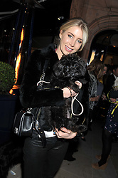 MISY McKEE and her dog Noodles at the launch of George's Dinner for Dogs menu in aid of The Dog's Trust held at George, 87-88 Mount Street, London on 19th March 2013.