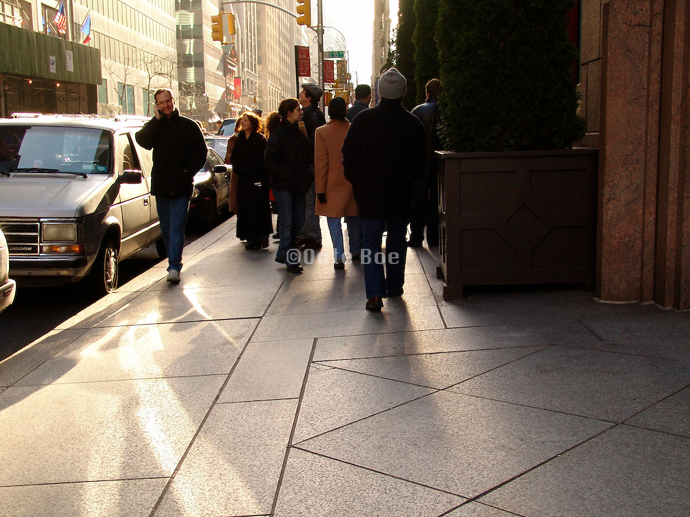 People walking on the pedestrian pad way.