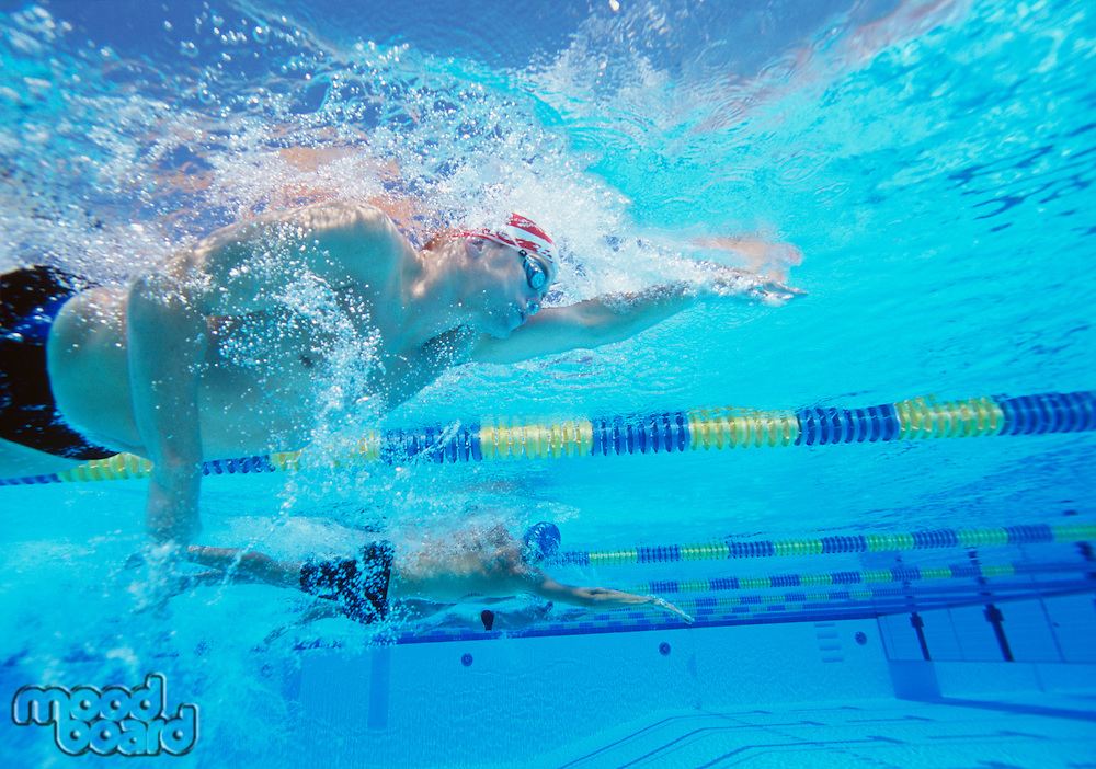 Underwater shot of three male athletes in swimming competition