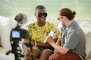 Cakes Da Killer being interviewed after performing at the Red Bull Sound Select stage at the Firefly Music Festival in Dover, DE on June 20, 2014.