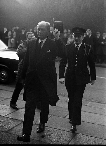 The State Funeral of Sir Alfred Chester Beatty at St. Patrick's Cathedral, Dublin. An Taoiseach Jack Lynch removes his hat as he enters the Cathedral..29.01.1968