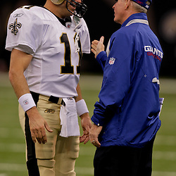 2009 October 18: New York Giants head coach Tom Coughlin talks with one of his former player current New Orleans Saints quarterback Mark Brunell (11) before the start of a 48-27 win by the New Orleans Saints over the New York Giants at the Louisiana Superdome in New Orleans, Louisiana.