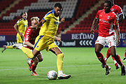 AFC Wimbledon striker Jake Jervis (10) witg a shot on goal during the EFL Trophy match between Charlton Athletic and AFC Wimbledon at The Valley, London, England on 4 September 2018.