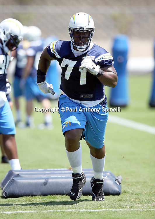 San Diego Chargers defensive end Damion Square (71) runs a drill during the San Diego Chargers Spring 2015 NFL minicamp practice held on Tuesday, June 16, 2015 in San Diego. (©Paul Anthony Spinelli)