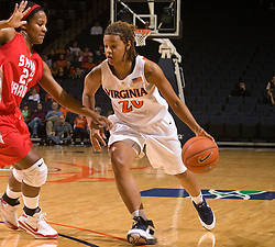 Virginia guard Kristen London (20) dribbles past St. Francis (PA) guard Quinessa Johnson (23).  The #15 ranked Virginia Cavaliers defeated the St. Francis (Pa.) Red Flash 82-66 in NCAA Women's Basketball at the John Paul Jones Arena on the Grounds of the University of Virginia in Charlottesville, VA on January 5, 2009.