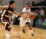 CMU freshman Austin McBroom (2) and WSU freshman Reggie Arceneaux (3) as the Central Michigan Chippewas play the Wright State University Raiders at the Nutter Center, Thursday, December 22, 2011.