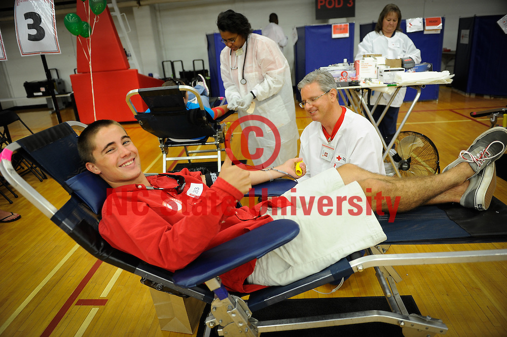 A student gives the thumbs up regarding his blood-giving experience.