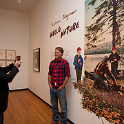 "William Wegman photographs artist Dan Dowd, who painted imagery on exhibition walls for ""Hello Nature"""