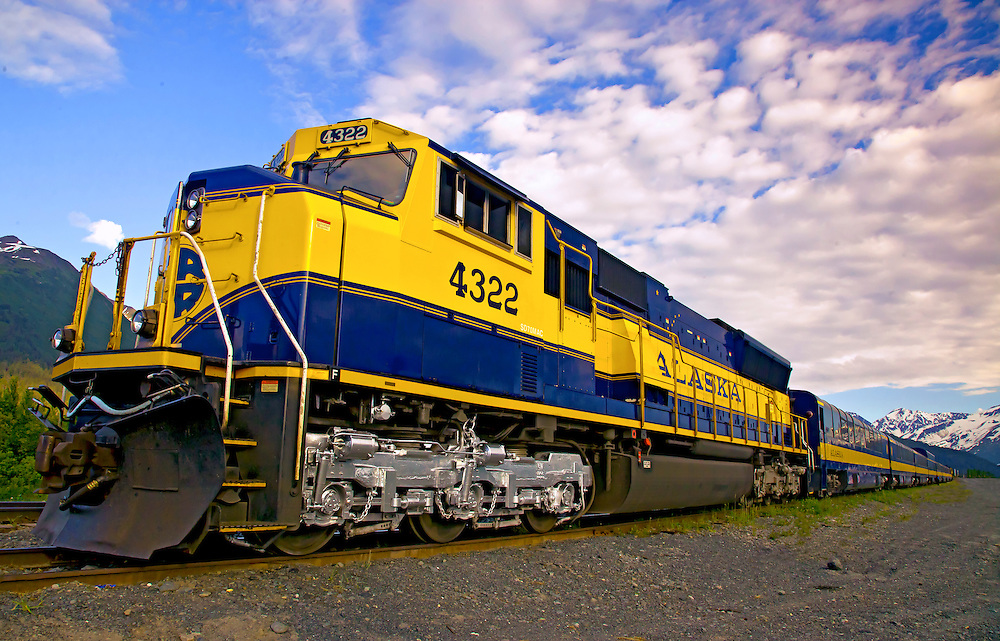 Alaska.  Alaska Railroad at the Portage Station, with mountains in the Chugach National Forest in the background.