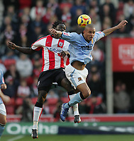 Photo: Lee Earle.<br /> Southampton v Hull City. Coca Cola Championship. 04/11/2006. Hull's Jason Jarrett (R) battles in the air with Kenwyne Jones.
