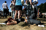 girl with dreads, acdc tshirt, sunbathing at Ashton Court Festival 2006