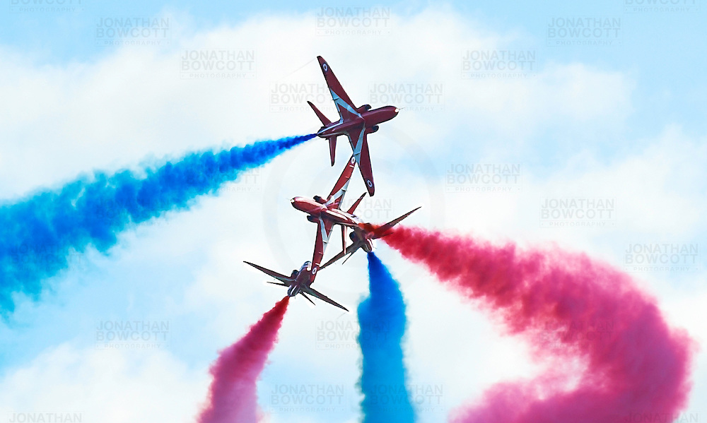 The Red Arrows perform a typically daring high speed manoeuvre. Demonstrating their skill at flying close to one another whilst maintaining safety and ensuring the crowds are thrilled.