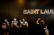 Protestors gather in front of a Saint Laurent store in Hong Kong's Central district, part of a gathering of thousands to form a human chain on the 30th anniversary of the Baltic Way (a human chain that stretched across Estonia, Latvia, and Lithuania).<br />